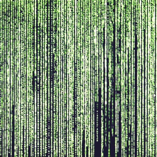 Vertical columns of green characters on a black background, as seen in The Matrix.